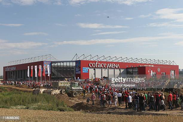 Fans of Mainz walk to the new Cofae Arena prior to the stadium opening at Coface Arena on July 3 2011 in Mainz Germany