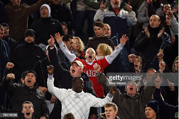 Fans of Manchester United sing prior to the UEFA Champions League match between AS Roma and Manchester United at the Olympic Stadium on December 12...