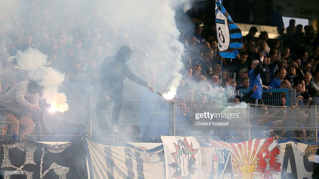 Fans of Mannheim burn smoke-bombs during the Third League play-off first leg match between SF Lotte and Waldhof Mannheim at Sportpark am Lotter Kreuz on May 25, 2016 in Lotte, Germany.