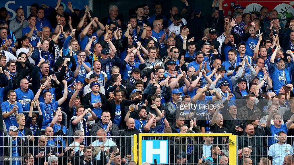 Fans of Mannheim celebrate during the Third League play-off first leg match between SF Lotte and Waldhof Mannheim at Sportpark am Lotter Kreuz on May 25, 2016 in Lotte, Germany.