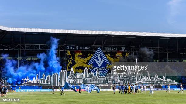 Fans of Mannheim show a choreographie and burn flares during the Third League playoff leg one match between Waldhof Mannheim and SV Meppen on May 28...