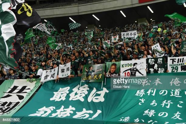 Fans of Matsumoto Yamaga cheer after the JLeague J2 match between Tokyo Verdy and Matsumoto Yamaga at Ajinomoto Stadium on September 10 2017 in Chofu...