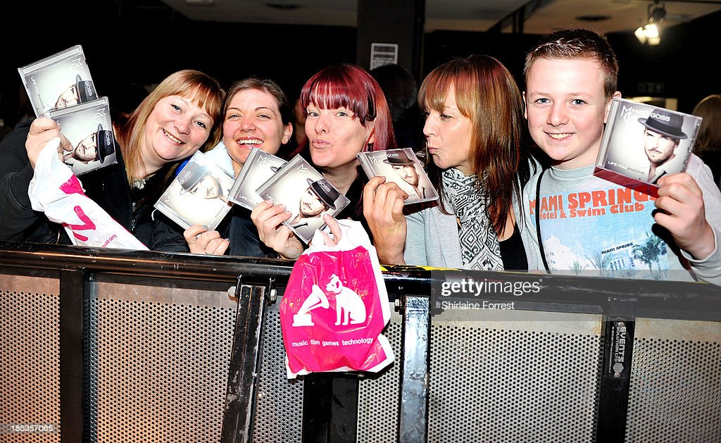 Fans of Matt Goss await the artist signing copies of his new album 'Life You Imagine' at HMV Manchester on October 19, 2013 in Manchester, England.