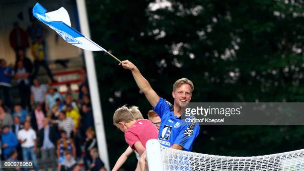 Fans of Meppen celebrate after winning 43 after penalty shootout the Relegation Regionalliga Play Off second leg match at Hensch Arena on May 31 2017...