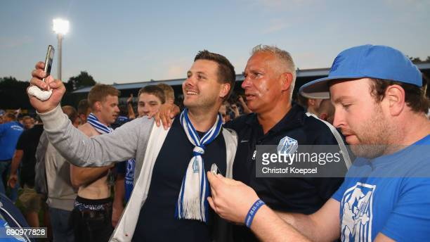 Fans of Meppen celebrate with head coach Christian Neidhart of Meppen after winning 53 after penalty shootout the Relegation Regionalliga Play Off...