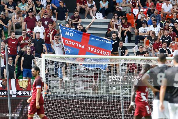 Fans of Metz with flag of fans of Crystal Palace which was stolen by Metz during the Friendly match between Metz and Crystal Palace on July 29 2017...