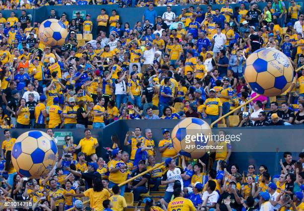 Fans of Mexican team Tigres cheer during the 2017 Mexican Apertura football tournament match against Puebla at the Universitario stadium in Monterrey...