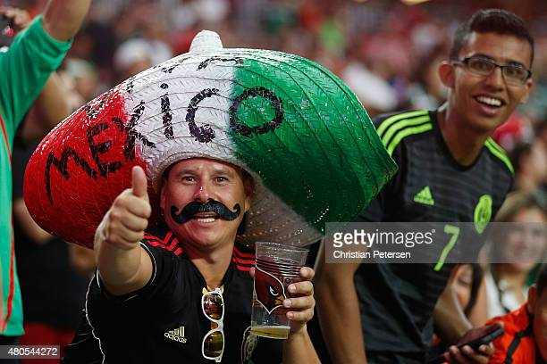 Fans of Mexico cheer during the first half of the 2015 CONCACAF Gold Cup group C match against Guatemala at University of Phoenix Stadium on July 12...