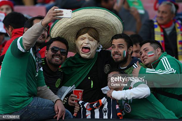 Fans of Mexico take a selfie prior the 2015 Copa America Chile Group A match between Chile and Mexico at Nacional Stadium on June 15 2015 in Santiago...