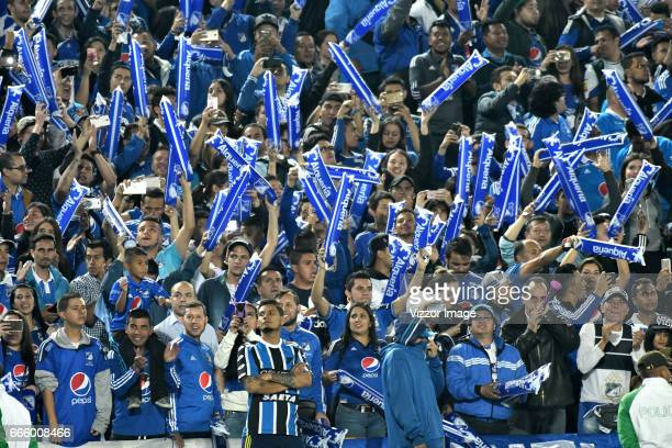 Fans of Millonarios cheer for their team during the match between Millonarios and Atletico Nacional as part of the Liga Aguila I 2017 at Nemesio...