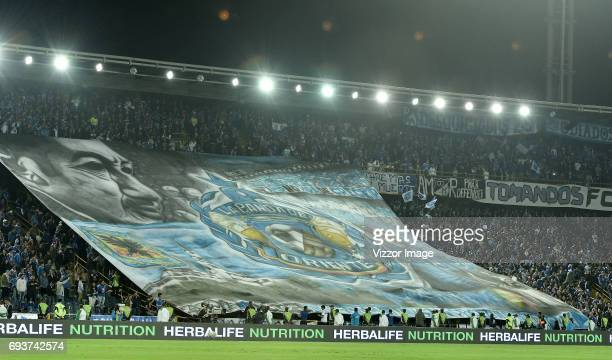 Fans of Millonarios cheer for their team during the Semi Finals first leg match between Millonarios and Atletico Nacional as part of Liga Aguila I...