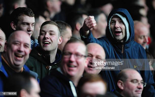 Fans of Millwall gesture during the FA Cup with Budweiser firth round match between Luton Town and Millwall at Kenilworth Road on February 16 2013 in...