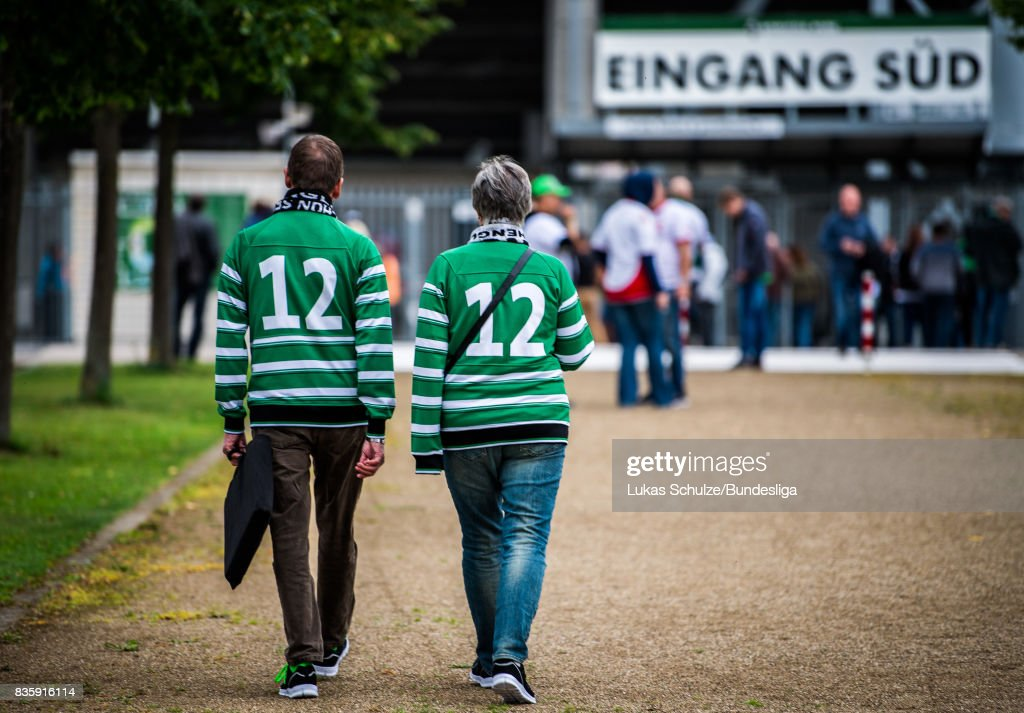 Fans of Moenchengladbach arrive prior to the Bundesliga match between Borussia Moenchengladbach and 1. FC Koeln at Borussia-Park on August 20, 2017 in Moenchengladbach, Germany.