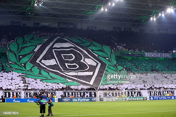 Fans of Moenchengladbach show a choreography during the UEFA Champions League playoff first leg match between Borussia Moenchengladbach and Dynamo...