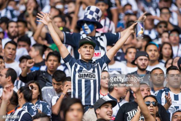 Fans of Monterrey cheer for their team during the 4th round match between Monterrey and Chivas as part of the Torneo Apertura 2017 Liga MX at BBVA...