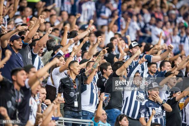 Fans of Monterrey cheer their team during the 13th round match between Monterrey and Pachuca as part of the Torneo Apertura 2017 Liga MX at BBVA...