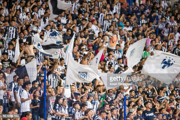 Fans of Monterrey display flags to cheer their team during the 13th round match between Monterrey and Pachuca as part of the Torneo Apertura 2017...