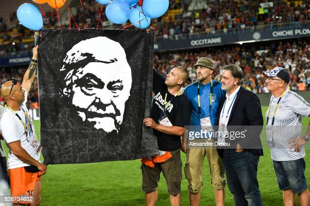 Fans of Montpellier banner tribute to Louis Nicollin with his son Laurent Nicollin president of Montpellier during the Ligue 1 match between...