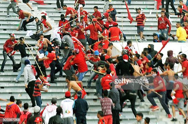 Fans of Morocco's Wydad Casablanca football club attack a policeman during riots between fans and the police following a football match between Wydad...