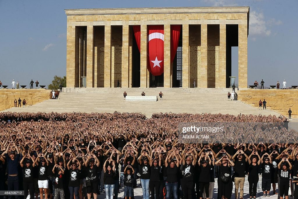 6000 fans of Mustafa Kemal Ataturk, the Turkish Republics founder, gather to form a giant Ataturk portrait at Ataturk's mausoleum during the week of Turkish Victory Day (30 August), in Ankara, on 26 August, 2014.