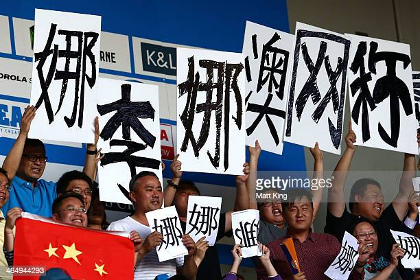 Fans of Na Li of China watch her in her women's final match against Dominika Cibulkova of Slovakia during day 13 of the 2014 Australian Open at...