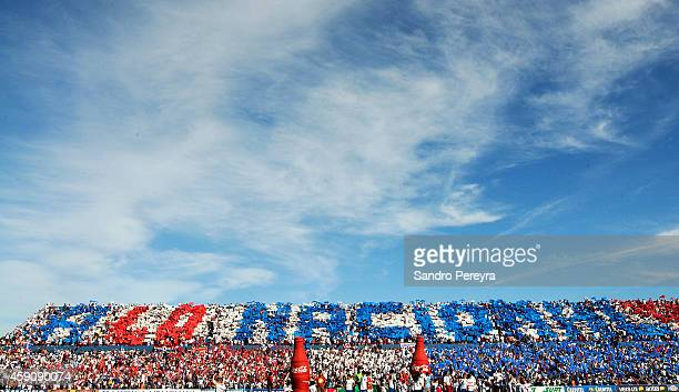 Fans of Nacional cheer for their team during a match between Cerro and Nacional as part of round 13 of Campeonato Apertura 2014 at Gran Parque...