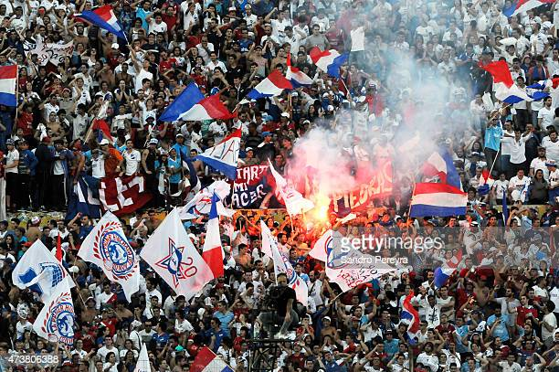 Fans of Nacional cheer for their team during a match between Penarol and Nacional as part of 12th round of Torneo Clausura 2015 at Centenario Stadium...
