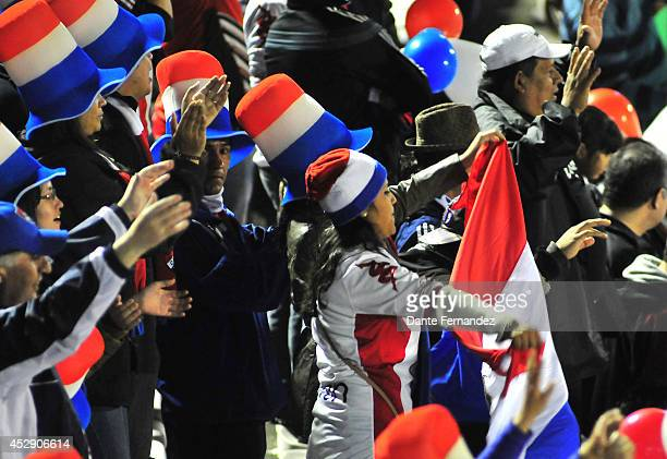 Fans of Nacional cheer for their team during a second leg semifinal match beteween Defensor Sporting and Nacional as part of Copa Bridgestone...