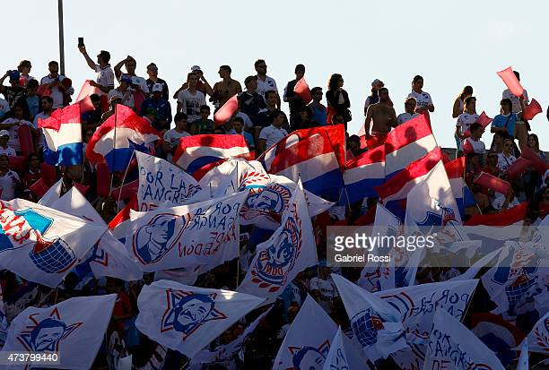 Fans of Nacional cheer for their team prior to a match between Peñarol and Nacional as part of 12th round of Torneo Clausura 2015 at Centenario...