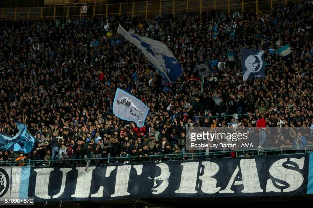 Fans of Napoli wave flags behind a banner which reads Ultras during the UEFA Champions League group F match between SSC Napoli and Manchester City at...