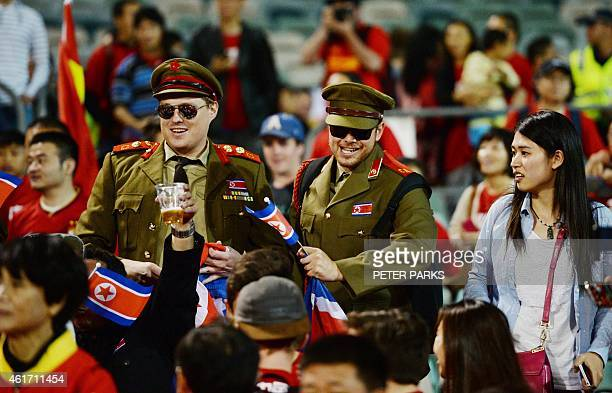 Fans of North Korea and China cheer during their Group B football match of the AFC Asian Cup in Canberra on January 18 2015 AFP PHOTO/Peter PARKS...