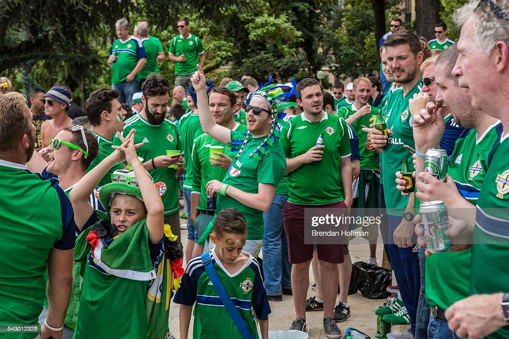 Fans of Northern Ireland celebrate near the Eiffel Tower before the football match between Wales and Northern Ireland during UEFA Euro 2016 tournament on June 25, 2016 in Paris, France. Wales edged Northern Ireland in the Round of 16 at Parc des Princes in Paris.
