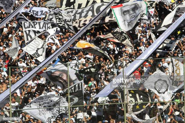 Fans of Olimpia cheer for their team during a match between Olimpia and Cerro Porteño as part of the 17th round of Torneo Apertura 2017 at Defensores...