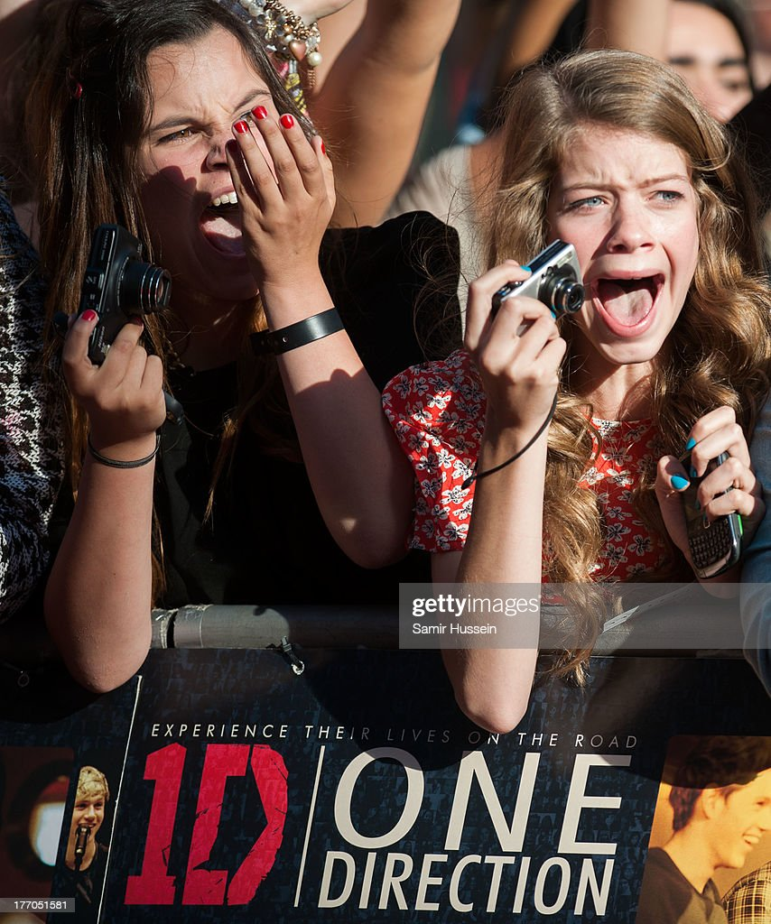 Fans of One Direction attend the World Premiere of 'One Direction: This Is Us' at Empire Leicester Square on August 20, 2013 in London, England.