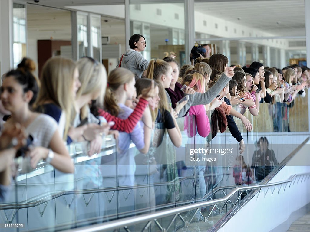 Fans of One Direction await the arrival for the first leg of the Australian Tour at Adelaide Airport on September 22, 2013 in Adelaide, Australia.