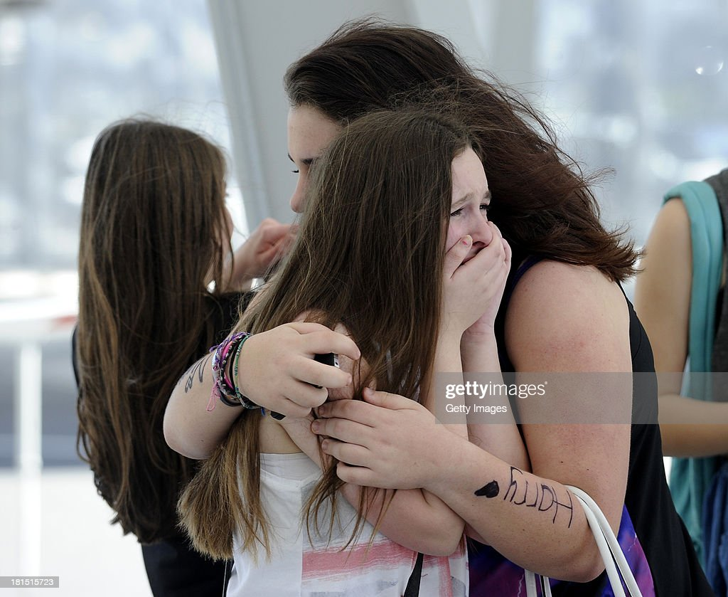 Fans of One Direction get emotional as Harry Styles arrive's for the Australian Tour at Adelaide Airport on September 22, 2013 in Adelaide, Australia.