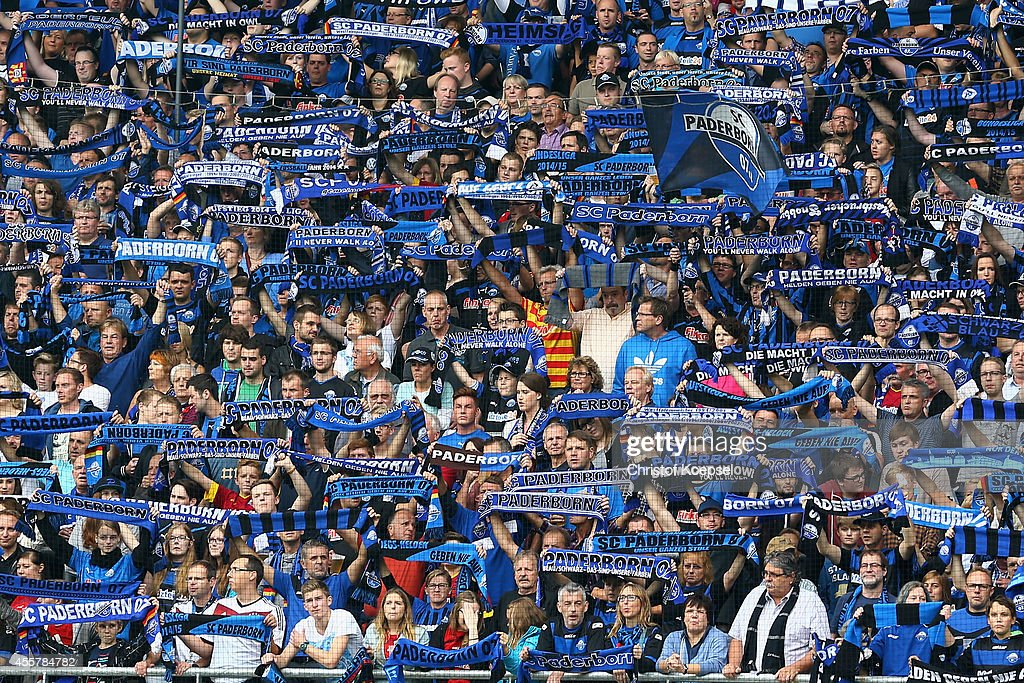 Fans of Paderborn celebrate during the Bundesliga match between SC Paderborn and Hannover 96 at Benteler Arena on September 20 2014 in Paderborn...
