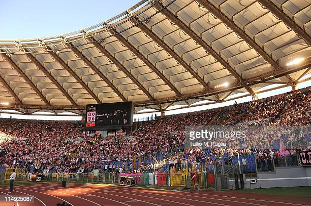 Fans of Palermo show their support before the Tim Cup final between FC Internazionale Milano and US Citta di Palermo at Olimpico Stadium on May 29...