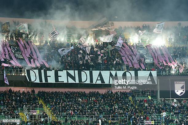 Fans of Palermo show their support displayng a nbanner reading 'defend it' during the Serie A match between US Citta di Palermo and Pescara Calcio at...