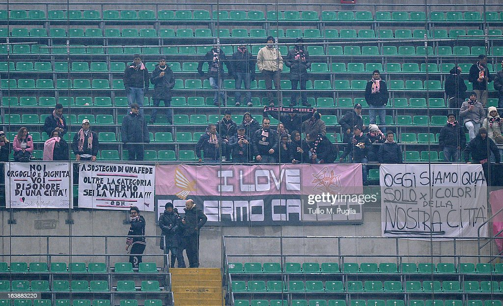 Fans of Palermo show their support during the Serie A match between AC Milan and US Citta di Palermo at San Siro Stadium on March 17, 2013 in Milan, Italy.