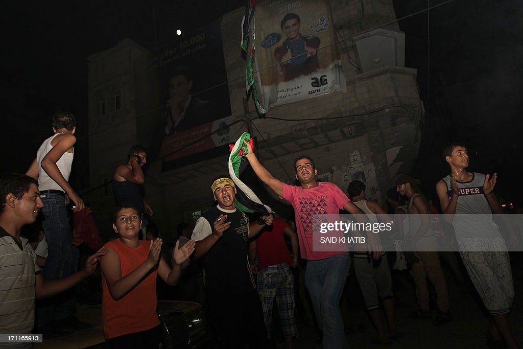 Fans of Palestinian singer Mohammed Assaf celebrate after he won the final of the Arab Idol competition in front house of Mohammed Assaf in Khan Yunis town in the southern Gaza Strip, 22 June 2013. Palestinians celebrated in the night from Saturday to Sunday's historic victory of the young singer in Gaza, Mohammed Assaf, became the idol of an entire people and their cause, and the most famous competition in the Arab talent show 'Arab Idol'. in a TV talent contest in Beirut. This is the first time in which they are shown on the existence of the Palestinians as brightly in this kind of artistic expression which aroused unprecedented interest in the Palestinian territories. AFP PHOTO/ SAID KHATIB