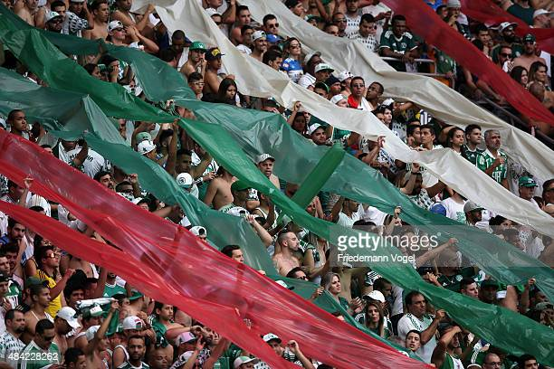 Fans of Palmeiras celebrates during the match between Palmeiras and Flamengo for the Brazilian Series A 2015 at Allianz Parque on August 16 2015 in...
