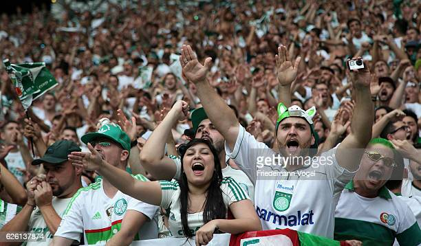 Fans of Palmeiras celebrates during the match between Palmeiras and Chapecoense for the Brazilian Series A 2016 at Allianz Parque on November 27 2016...