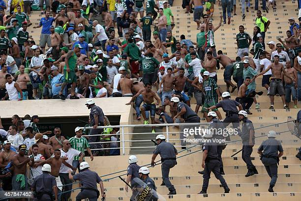 Fans of Palmeiras fights with the police during the match between Palmeiras and Corinthians for the Brazilian Series A 2014 at Estadio do Pacaembu on...