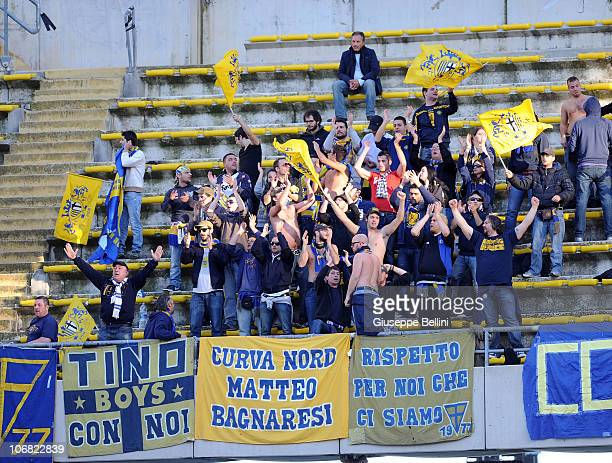 Fans of Parma support in the stands during the Serie A match between Bari and Parma at Stadio San Nicola on November 14 2010 in Bari Italy