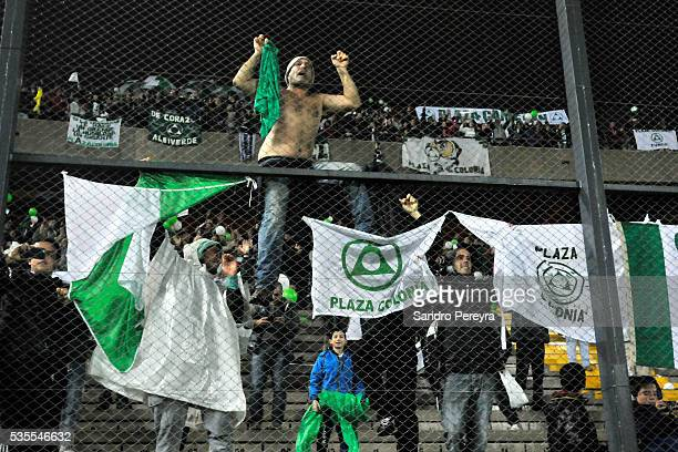 Fans of Plaza Colonia cheer for their team during a match between Penarol and Plaza Colonia as part of Campeonato Uruguayo at Campeon del Siglo...