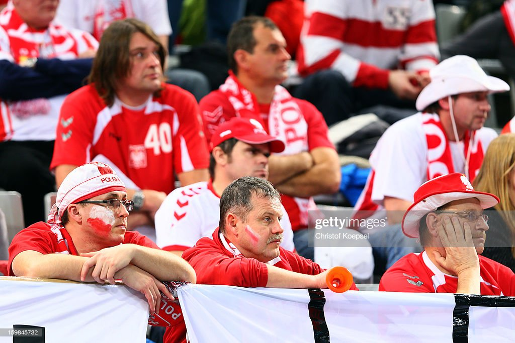 Fans of Poland look dejected after the round of sixteen match between Hungary and Poland at Palau Sant Jordi on January 21, 2013 in Barcelona, Spain.