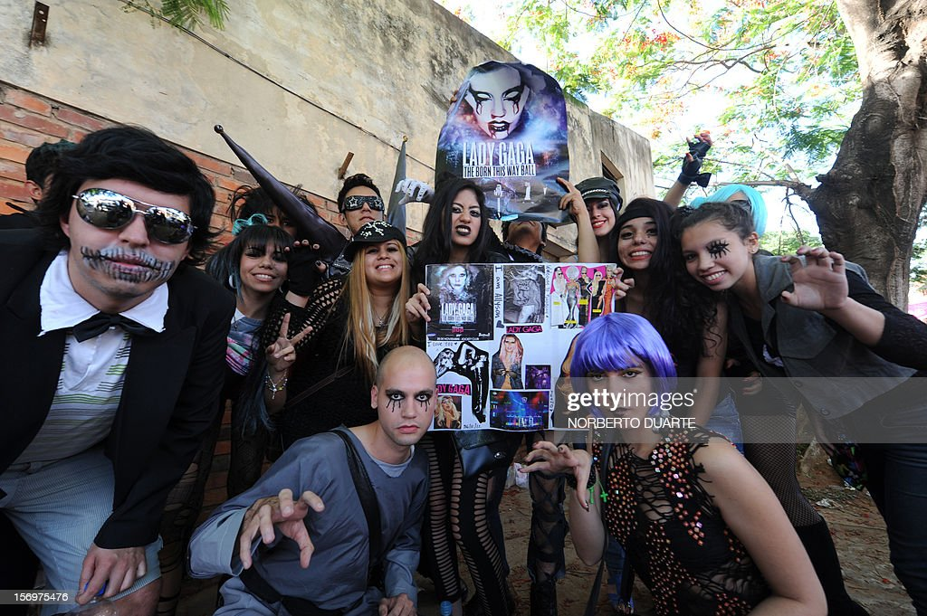 Fans of pop diva Lady Gaga, currently on tour in South America, pose as they queue waiting to get inside the venue for the show the singer will offer in the Paraguayan capital, Asuncion, on November 26, 2012.