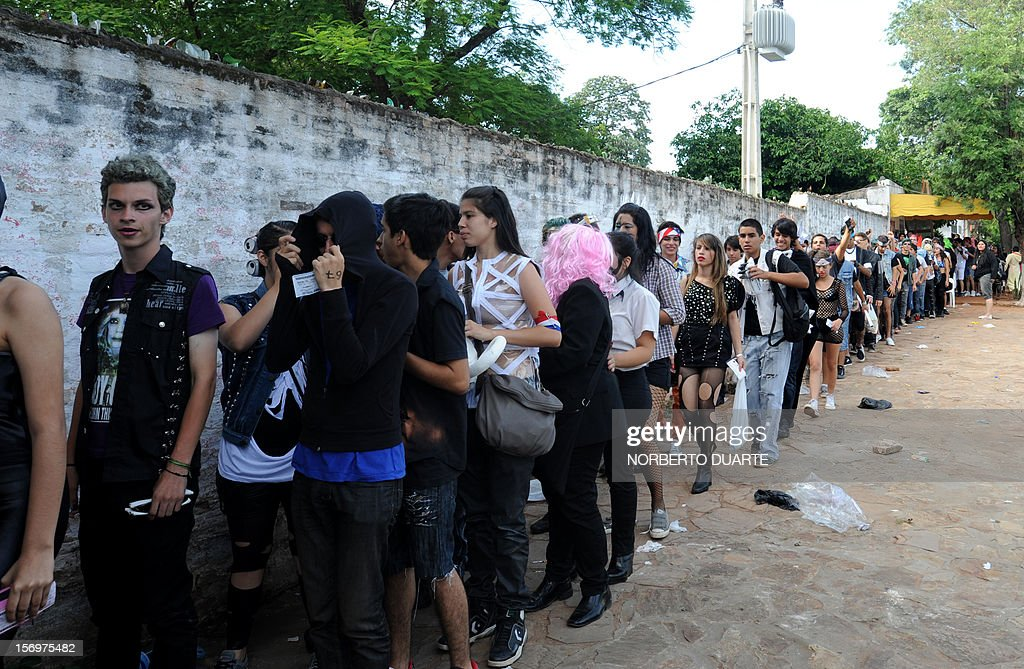 Fans of pop diva Lady Gaga, currently on tour in South America, queue waiting to get inside the venue for the show the singer will offer in the Paraguayan capital, Asuncion, on November 26, 2012.