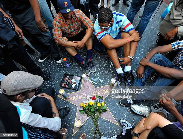 Fans of pop star Michael Jackson sit vigil at talk radio host Michael Jackson's Star on the Hollywood Walk of Fame mourning his death on June 25 2009...